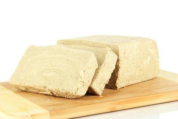 Tasty halva on cutting board isolated on white