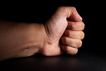 Angry man banging fist on table