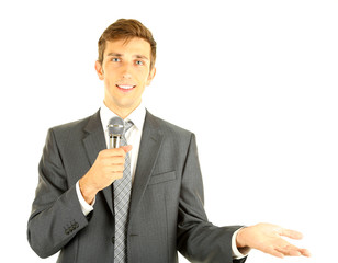 Young businessman talking with microphone, isolated on white