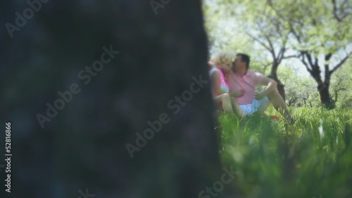 romantic couple of lovers walk in the garden, defocused