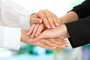 United hands, on bright background