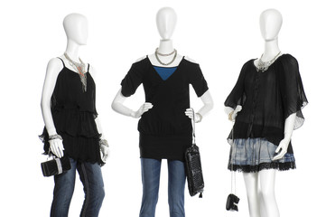 female mannequins in clothes with on white background