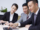 asian business people working together in office