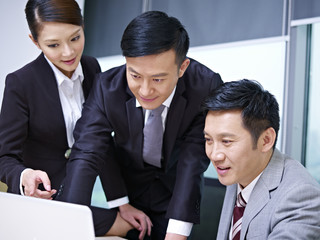 a team of asian business people working in office