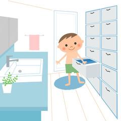 洗面所で着替えを取る男の子