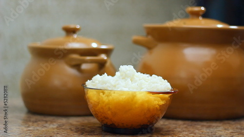 a plate of cooked rice in hands