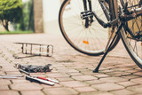 Real repair of bicycle in the court pavement