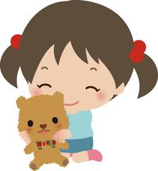 テディベアを抱いた小さな女の子