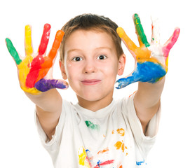 boy shows his hands painted with paint