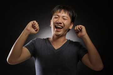 laughing young asian man portrait
