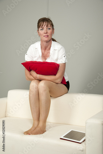 Quot Woman Wearing Short Skirt Sitting On A Sofa Quot Stock Photo