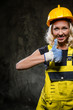 Attractive builder woman with thumbs up