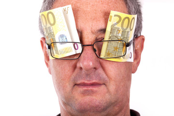 Man with banknotes behind the glasses