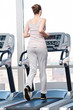 Woman at gym exercising. Run on machine