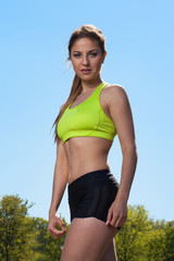 Beautiful young woman in fitwear outdoors