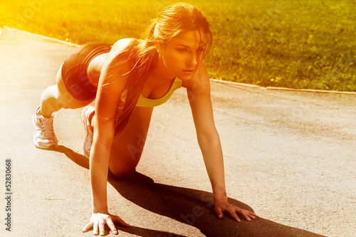 Beautiful young woman ready to run