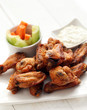 Chicken wings with sauce and vegetables