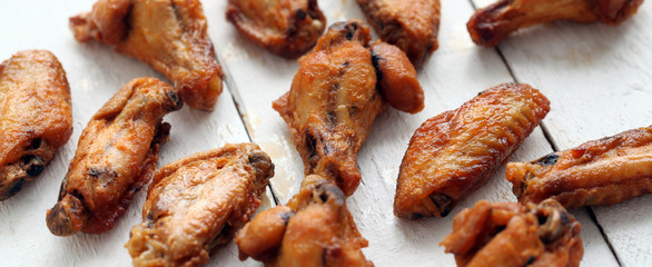Grilled chicken wings on a white table
