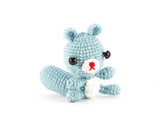 handmade crochet Raccoon doll on white background