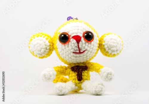 handmade crochet monkey doll on white background