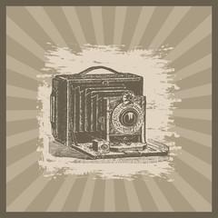 Vintage camera illustration on sunburst background
