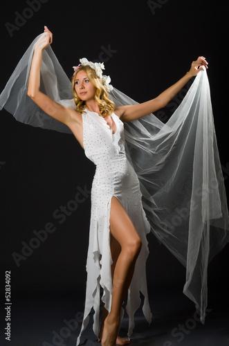 Woman in wedding dress dancing
