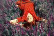 Girl lying on spring grass and flowers.