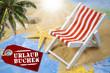 Liegestuhl auf Landkarte mit Sand und Seestern
