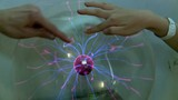 Hands at Plasma globe