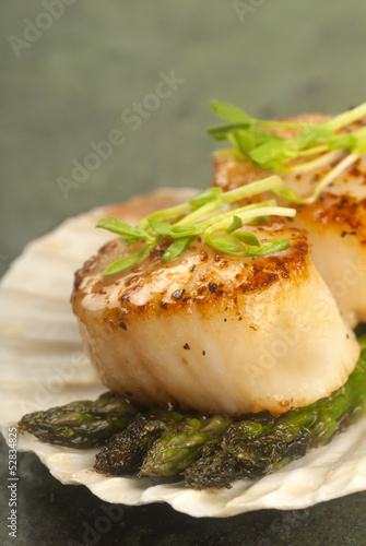 Sea Scallop with asparagus in a scallop shell