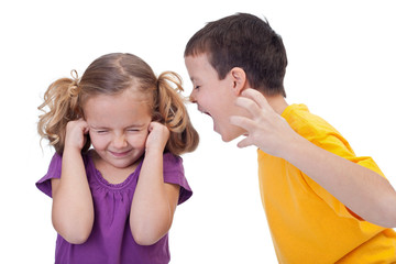 Quarreling kids - boy shouting to girl