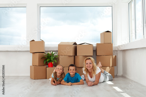 Happy woman and kids in their new home