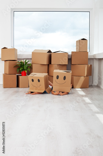 Kids having fun while moving in a new home