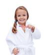 Little girl in bathrobe washing teeth