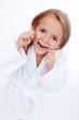 Little girl flossing