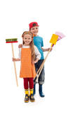 Kids with gardening utensils and rubber boots - isolated