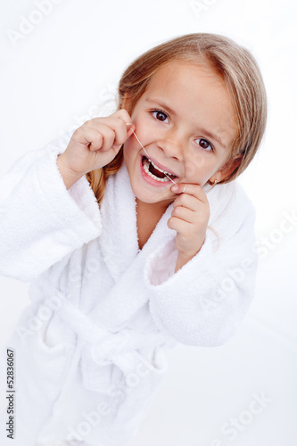 Little girl flossing