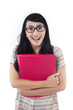 Happy female student bring red folder - isolated