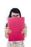 Asian female student hide behind red folder - isolated