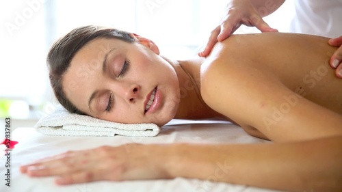 Beautiful woman receiving body massage