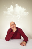 Worried man with lot of questions