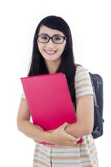 Attractive female student with backpack on white