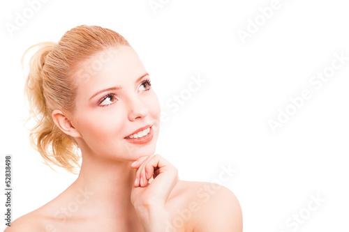 attraktive junge blonde Frau beim grübeln