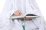 Close-up woman reading Kuran on white