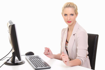Businesswoman working on a computer at her office desk