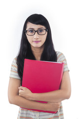 Confident female student with red folder - isolated
