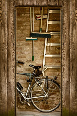 Retro styled image of a shed with a bicycle inside