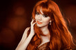 Hairstyle. Red Hair. Attractive smiling girl with long Curly Hai
