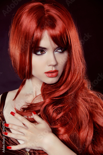 Fototapeta Red Hair. Fashion Girl Portrait with long Curly Hair isolated on