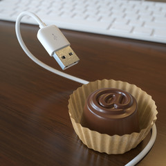 Conceptual Picture With Candy And USB Cable